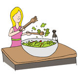 Tossed Salad. An image of a woman making a tossed salad Royalty Free Stock Photography