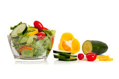 Tossed salad and ingredients on white Stock Image