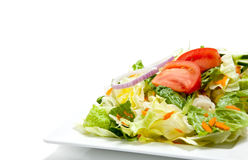 Tossed salad on a plate on a white background Royalty Free Stock Image