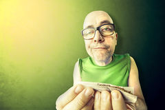 Tossic and relaxed man rolling herb. And tobacco Stock Images
