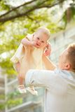 Tossing a baby Stock Photo