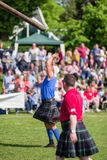 Tossing the caber discipline at Scottish Highland games royalty free stock photography