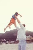 Tossing child dad Stock Images