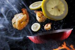 Free Tossing Cooking Lemon Shrimp Royalty Free Stock Photo - 174494285
