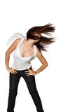 Tossing hair to the side while dancing. Young woman flinging her hair to the side with flowing hair Stock Photos