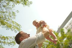 Tossing a kid. Man tossing his kid, view from below Royalty Free Stock Photo