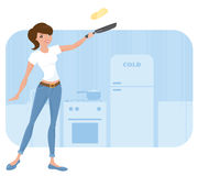 Tossing Pancakes. Woman tossing a fresh pancake Royalty Free Stock Photography
