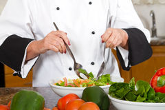 Tossing salad Stock Photos