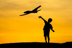 Tossing a toy plane. Stock Images
