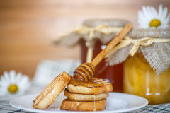 Tostada con la miel Imagenes de archivo