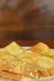 Tostada con mantequilla y la aspersión con el azúcar Foto de archivo libre de regalías