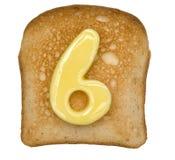 Tostada con número de la mantequilla fotos de archivo