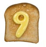 Tostada con número de la mantequilla foto de archivo libre de regalías