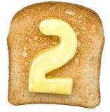 Tostada con número de la mantequilla imagen de archivo