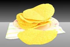 tostada corn tortilla shells on black white background Royalty Free Stock Photography