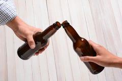 Tostada de la botella de cerveza Fotografía de archivo libre de regalías