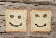 Tostada feliz en un de madera viejo imagen de archivo