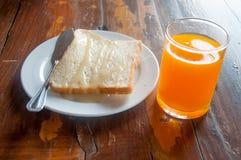 Tostada, jugo y leche del desayuno Fotos de archivo libres de regalías
