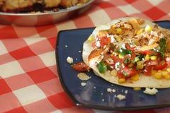 Tostada with salmon and corn salsa Royalty Free Stock Photos