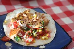 Tostada with salmon and corn salsa Stock Images