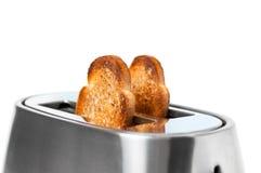 Tostada tostada fresca y un cierre de la tostadora para arriba Imagenes de archivo