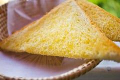 Tostada untada con mantequilla Imagenes de archivo
