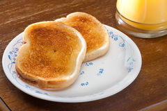 tostada y zumo de naranja por la mañana Fotos de archivo