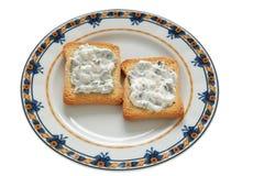 Tostadas con el queso poner crema Imagenes de archivo