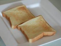 Tostadas en la placa blanca Imágenes de archivo libres de regalías
