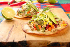 Tostadas with ground beef and vegetables on wooden background Stock Images