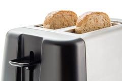 Tostadora con las rebanadas del pan Imagen de archivo