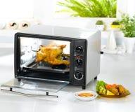 Tostapane automatico elettrico del pollo Immagine Stock