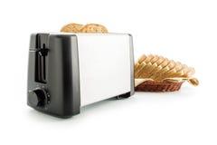 Tostapane con le fette del pane Fotografie Stock