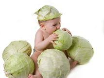 Tot plays with cabbage stock image