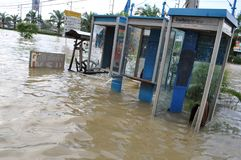 TOT public telephones are underwater in Pathum Thani, Thailand, in October 2011.  Stock Photography