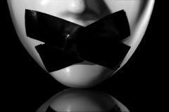 Tot zwijgen gebracht masker stock foto