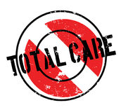 Total Care rubber stamp. Grunge design with dust scratches. Effects can be easily removed for a clean, crisp look. Color is easily changed Stock Photos