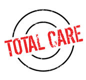Total Care rubber stamp. Grunge design with dust scratches. Effects can be easily removed for a clean, crisp look. Color is easily changed Stock Photo