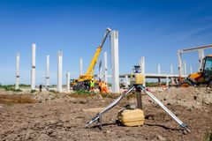 Modern device makes topographic measurements with laser, total c. Total center device with laser for leveling other devices to level construction site Stock Image
