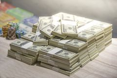 A total of hundreds of dollars.Betting is a bet for investors. The gambling concept. Businessmen are gambling in casinos.soft focu stock photos