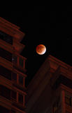 Total lunar eclipse at 2011.12.11. Total lunar eclipse with building at 2011.12.11 Tiantongyuan subdistrict Royalty Free Stock Photo