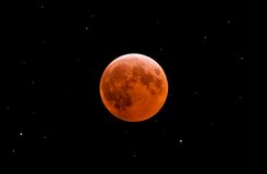 Total lunar eclipse. Total moon eclipse among the stars Royalty Free Stock Image