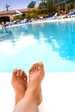 Total relaxation by the pool Royalty Free Stock Images