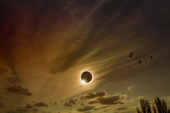 Total solar eclipse. Amazing scientific background - total solar eclipse in dark red glowing sky, mysterious natural phenomenon when Moon passes between planet royalty free stock photography