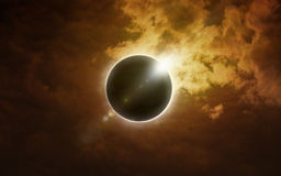 Total solar eclipse in dark glowing sky Stock Photos