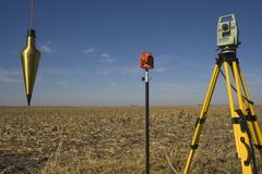 Total station, prism and plumb-bob Stock Photos