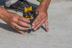 Total station prism with survey worker hands 2 Royalty Free Stock Photography