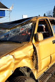 Totaled car. Golden SUV car crash: out of the ditch after the accident and parked outside at the garage Stock Photos