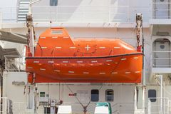 Totally enclosed lifeboat on a cargo ship Stock Image