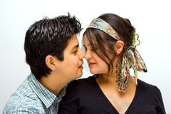 Totally in love!. Couple sitting, he's approaching her as their noses touch stock photos